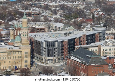 Indianapolis, IN / USA - December 19, 2019:  Looking NE towards recently completed Penrose on Mass Apartment/Retail Building. The Old National Center is to the West and the Athenaeum is South
