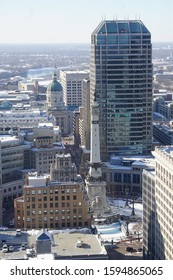Indianapolis, IN / USA - December 19, 2019: Monument Circle with Snow and Christmas Decor in the Central Business District