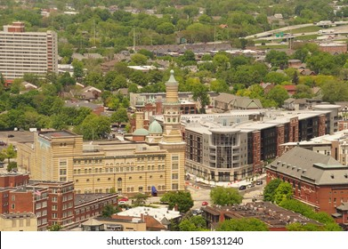 Indianapolis, IN / USA - May 15, 2019: Looking NE towards Murat Theatre at Old National Centre, Penrose on Mass Apartments, and the Athenæum at intersection of Michigan St., New Jersey  and Mass Ave