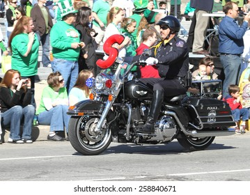 INDIANAPOLIS,INDIANA-MARCH 17:Indianapolis Metropolitan Police with Motorcycle at the Annual St Patrick's Day Parade.March 17,2010 in Indianapolis,Indiana,USA.