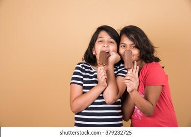 girls lick mango