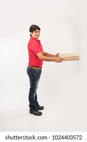 Indian/Asian Handsome Delivery Man with Box, isolated over white background