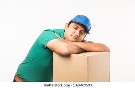 Indian/Asian Handsome Delivery Man sleeping over Box, isolated over white background