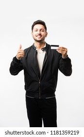 Indian/asian man with credit or debit card or electronic plastic swipe card, isolated over white background