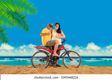 Indian/Asian Retired couple with their bike/bicycle on the beach, moody effect
