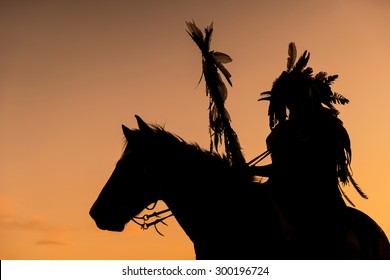 The Indians are riding a horse and spear ready to use In light of the Silhouette
