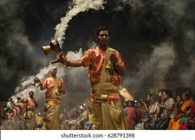 India,Varanasi-March 15,2017:They pray..They are at the center of Varanasi and they ritualize of Aarti.Aarti ritual everyday at 18:00 seaside of the Ganges.