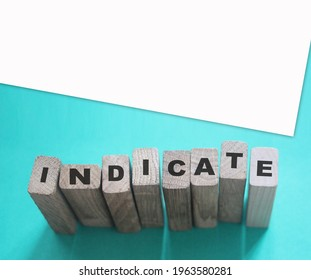 Indicate word on wooden blocks on cyan background. Financial indicator Unsecured and secured bonds or KPI concept - Shutterstock ID 1963580281