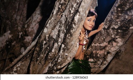 Indigene woman in the palm skirt and coconut lians