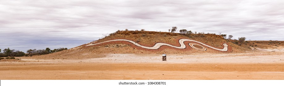 Indigenous artwork of a dreamtime serpent on a hill at Betoota, south-west of Longreach Queensland public artworks to tell women's Dreamtime stories of the Mithika, Wangkamadla and Wangkangurru people