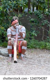 Indigenous Australian man play Aboriginal  music on didgeridoo, instrument in Queensland, Australia.