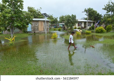 Indigenous Fijian girl walks in flooded land in Fiji. On Feb 2016 Severe Tropical Cyclone Winston was the strongest tropical cyclone in Fiji in recorded history.
