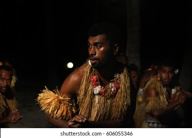 Indigenous Fijian men dancing a traditional male dance meke wesi the spear dance. Real people copy space