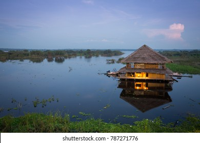 Indigenous floating house at night in Iquitos, Peru in the Amazon rainforest
