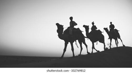 Indigenous Indian Riding Through Desert Camel Concept