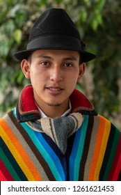 Indigenous from the province of Cotopaxi in Ecuador with his multicolored poncho and black hat