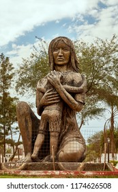 Indigenous Quechua Woman Traditional Bronze Statue of Mother Warrior feeding Son in her Breast. Monument located in a Square of a Small Village in RN 81 Argentine road to Salta Northern Region