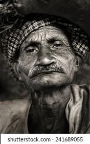 Indigenous senior Indian man looking grumpy at the camera.