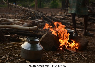 Indigenous Tribal peoples method of making alcohol from Mahua flower on a small fire