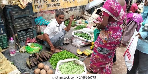 Indigenous tribal vegetable vendors selling fresh local vegetables at the Agartala market, Tripura, India on 3 August 2019
