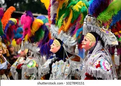 Indigenous wearing wooden masks during celebration at Chichicastenango, Guatemala