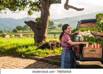 Indigenous woman with her truck full of vegetables in a rural area of Guatemala.