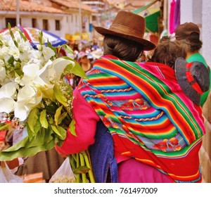 Indigenous woman selling lilies in Cusco, Peru, March 2016