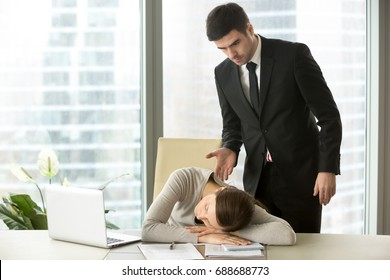 Indignant angry boss caught tired lazy employee sleeping at workplace, dissatisfied executive found exhausted overworked subordinate asleep at desk, mad ceo waking up bored worker dozing in office