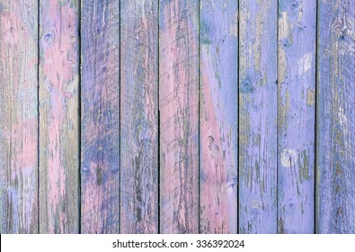Indigo blue  wooden planks background - Colorful outer fence deteriorated by time - Closeup of wood board painted surface - Fashion background with vintage color - Original colors focus from middle