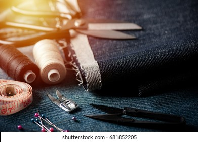 indigo denim fabric with sewing equipments, garment industrial concept.