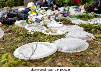 Indiscriminate litter of plastic non-biodegradable at garbage dump bad for environment