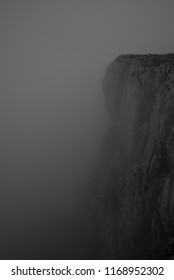 Indistinct rockface in a foggy environment