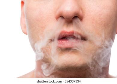 individual human smoking and cloud of smoke closeup