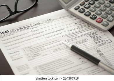 Individual Income Tax return form on desk