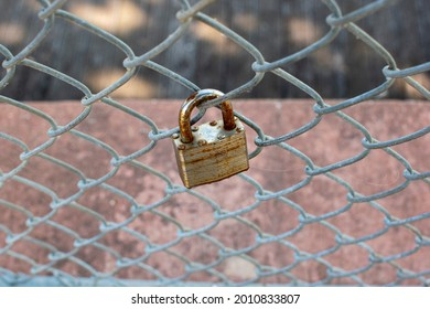 Individual Padlock Locked on Silver Fence