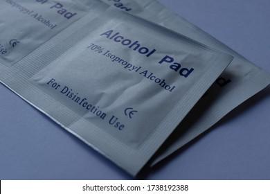 Individual Sachets of Alcohol Wipes Pads, 70% Isopropyl, Extreme Macro Close Up on Plain White Background