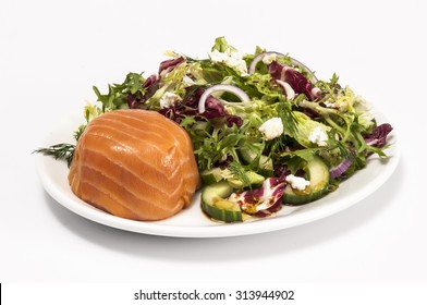 Individual smoked salmon terrine with a mixed green salad isolated on white
