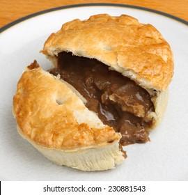 Individual steak meat pie cut open.