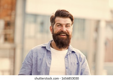 As individual as you are. happy hispter outdoor. Confident and handsome brutal man. Hair and beard care. Male barber care. brutal hipster with moustache. Mature hipster with beard. Bearded man.