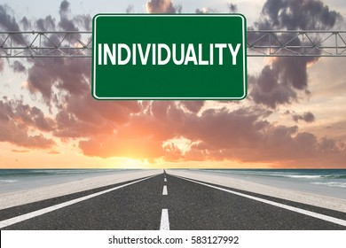Individuality highway sign and road to sunset
