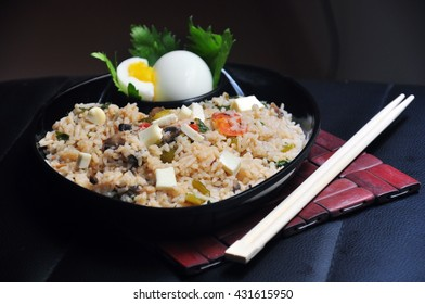 Indochinese fried rice platter with vegetables, tofu and egg