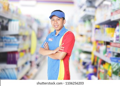indomaret happy asian male shopkeeper. asian male shopkeeper standing in front of the groceries store. yogyakarta indonesia. june 06, 2018.