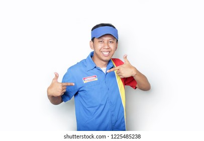 indomaret smiling asian man shopkeeper. indonesian man shopkeeper standing isolated. yogyakarta indonesia. november 9, 2018.