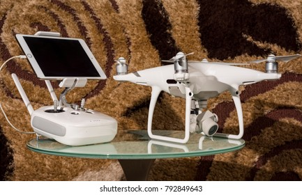 Indonesia. 14 January 2018: Drone complete set of DJI Phantom 4 Professional with 4K video, 20 megapixels camera, paired with Apple iPad mini 3.