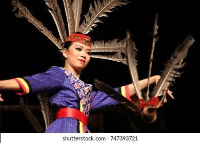 "Indonesia 4th of April 2017. A woman dancing ""Malap Merinu dance. Malap Merinu was traditional dance traditional dance from Lamandau, Central Kalimantan, Indonesia (Tari tradisional Kalimantan)"