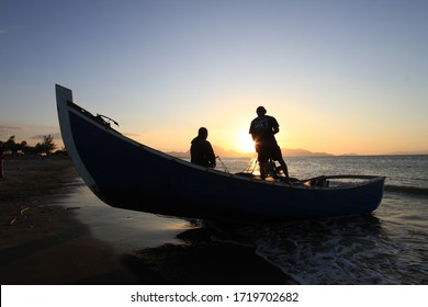 Indonesia, Aceh, 06 January 2020 Traditional Banda Aceh fishermen tidy their nets after anchoring their nets at sea at sunset