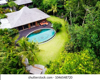 INDONESIA, BALI, CANGGU  - FEBRUARY 24, 2018: Villa AUGEN. A large villa on the island of Bali with a large swimming pool in the form of an eye. Luxury vacation in the green corner of Canggu District.