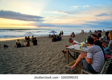 INDONESIA, BALI, CANGGU  - MARCH 15, 2018: Beach ECO. Overflowing with all the colors of the rainbow, a sunset with a lot of people. Everyone enjoying the rays of the passing sun.