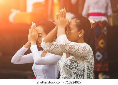 INDONESIA, BALI - July 08, 2017:  People praying at  Hindu Temple of Bali.