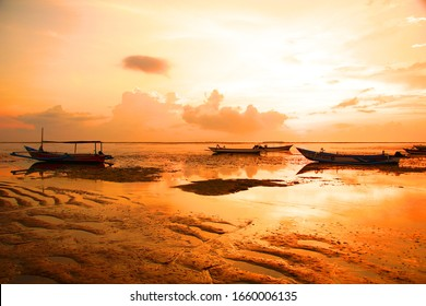 INDONESIA, BALI, SANUR - NOVEMBER 07, 2013: The colors of dawn and a fantastically beautiful sunrise on the ocean in an old fishing village
